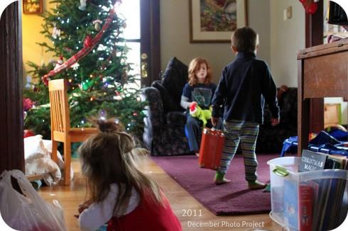 kids around a Christmas tree